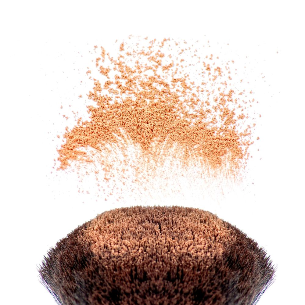 18495032 - makeup brushes and powder in motion